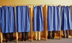 Considering the quality of the candidates, the resemblance between this picture of people voting and men taking care of business at urinals may be appropriate.